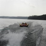 behind boat